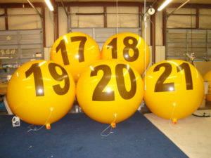 buy giant balloons for business promotions. yellow color helium advertising balloons