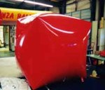 giant red color cube shape helium advertising balloon.
