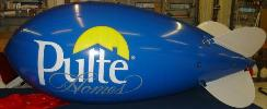 helium advertising blimp - blue color blimp with Pulte logo